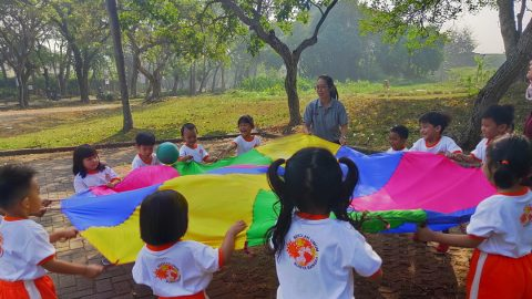 """TK A 1 """"Parachute games using ball. it called """"don't drop the ball (team play)"""""""